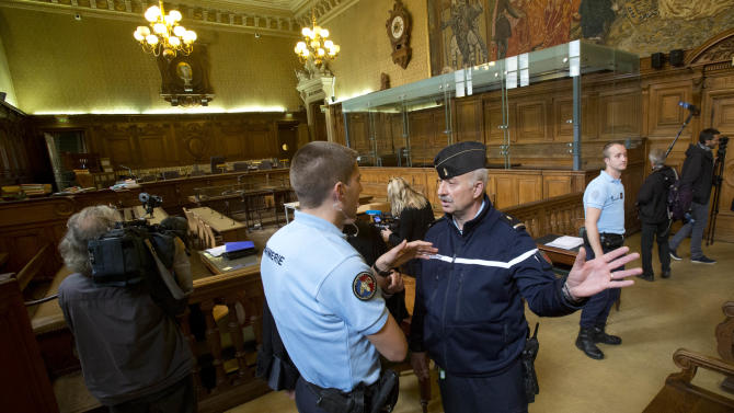 "Police officers talk inside the courtroom where  Venezuelan convicted terrorist known as ""Carlos the Jackal"", or Illich Ramirez, is due to appear  Monday, May, 13, 2013 in Paris. Carlos the Jackal, the flamboyant terrorist and self-proclaimed revolutionary who was once one of the Cold War's most wanted men, is appealing his life sentence for orchestrating bombings in France two decades ago. Carlos, whose real name is Ilich Ramirez Sanchez, is serving two life sentences in France for a triple murder in 1975 and for the bombings in France in 1982 and 1983 that killed 11 people and injured more than 140. He's been jailed since French agents seized him in Sudan in 1994. (AP Photo/Michel Euler)"