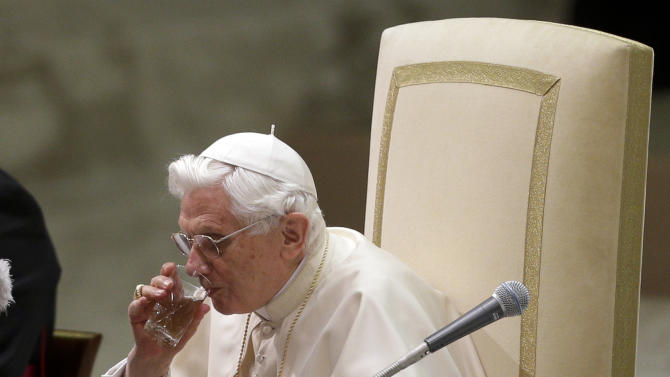 Pope Benedict XVI drinks during his weekly general audience in Hall Paul VI, at the Vatican, Wednesday, Dec. 19, 2012. (AP Photo/Alessandra Tarantino)