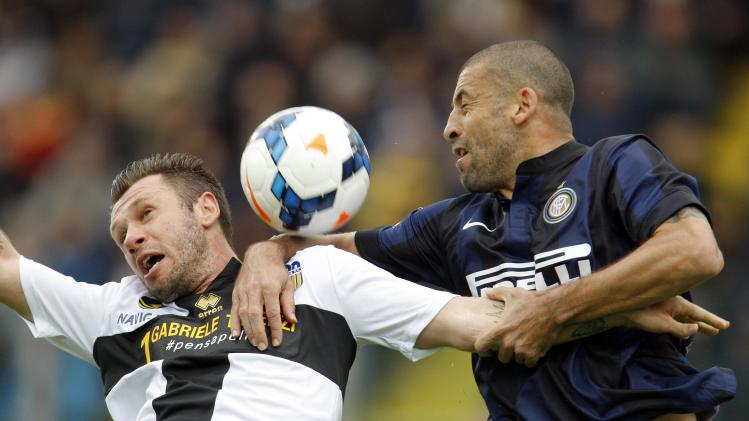 Inter Milan's Samuel challenges Parma's Cassano during their Italian Serie A soccer match at the Tardini stadium in Parma