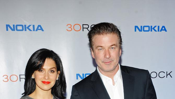 """FILE - This Dec. 20, 2012 file photo released by Nokia shows Hilaria Thomas, left, and actor Alec Baldwin at the Nokia """"30 Rock"""" wrap party in New York.            A representative for Alec Baldwin says the """"30 Rock"""" star and his wife Hilaria are expecting their first child together. Baldwin, 54, is already the father of a 17-year-old daughter, Ireland, from his previous marriage to actress Kim Basinger. (AP Photo/Nokia, Scott Gries, file)"""