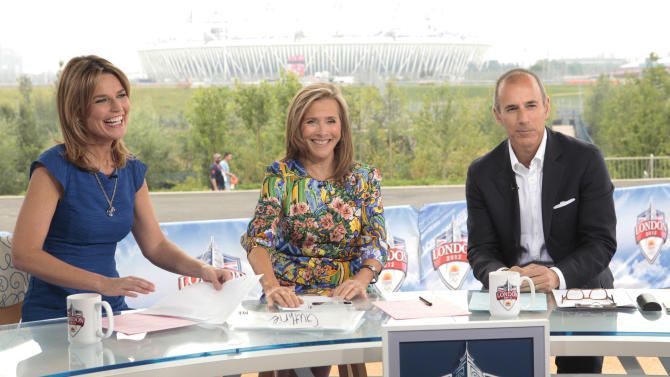 """This July 27, 2012 photo shows, from left, co-hosts of the """"Today"""" show, from left, Savannah Guthrie, Meredith Vieira, and Matt Lauer during a broadcast of the morning news program from London. NBC is set to """"break even"""" on its Olympics coverage, rather than lose money as previously expected, the head of NBCUniversal said Wednesday, Aug. 1. The company had expected at one point to take a $200 million loss on the London Olympics. NBC paid $1.2 billion for the rights to show the games on TV and online in the U.S. It has said that it sold more than $1 billion in ads, breaking the record of $850 million set during the Beijing Olympics in 2008. (AP Photo/NBC, Paul Drinkwater)"""
