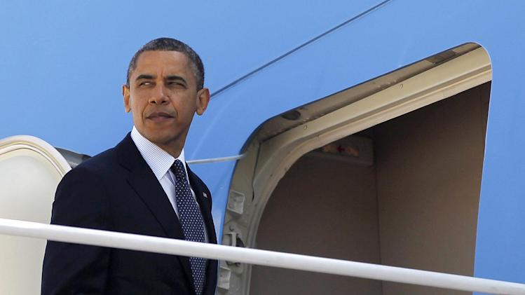 President Barack Obama prepares to board Air Force One before his departure from Andrews Air Force Base, Md.,Thursday, May, 10, 2012. Obama is traveling to the West Coast for a series of campaign fundraisers. (AP Photo/Pablo Martinez Monsivais)