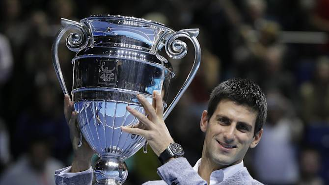 Novak Djokovic of Serbia holds the ATP World Tour No 1 Award trophy after being presented with two ATP World Tour Awards during a ceremony at the ATP World Tour Finals in London Tuesday, Nov. 6, 2012. (AP Photo/Kirsty Wigglesworth)