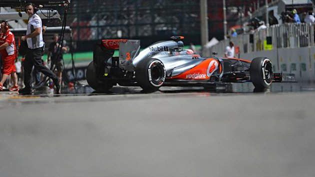 British Formula One driver Jenson Button leaves the McLaren pits during the second free practices on November 23, 2012 at the Interlagos speedway in Sao Paulo, Brazil. AFP