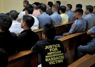 A man wears a protest T-shirt during the ongoing trial in Manila of the Ampatuans, a political clan accused of masterminding the country&#39;s worst massacre. Hearings are held just once a week and lawyers expect proceedings to drag on for years or even decades in the Philippines&#39; backlogged justice system. Prosecutors have complained of delaying tactics by the defence