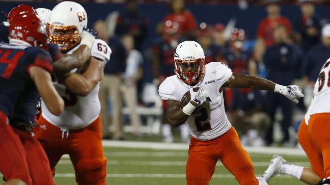 UTSA's Jarveon Williams (2) runs for a first down against Arizona during the first half of an NCAA college football game, Thursday, Sept. 3, 2015, in Tucson, Ariz. (AP Photo/Rick Scuteri)
