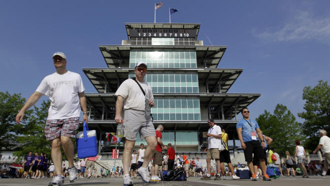 Race fans cross the yard of bricks in front of the Pagoda on their way to their seats before the running of the 96th Indianapolis 500 auto race at the Indianapolis Motor Speedway in Indianapolis, Sunday, May 27, 2012. (AP Photo/Darron Cummings)