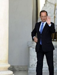 France&#39;s President Francois Hollande waves as he leaves the Elysee presidential Palace at the end of the weekly cabinet meeting, on July 25. Hollande told ministers that &quot;the decision of the European Council at the end of June absolutely must be implemented rapidly and firmly.&quot;