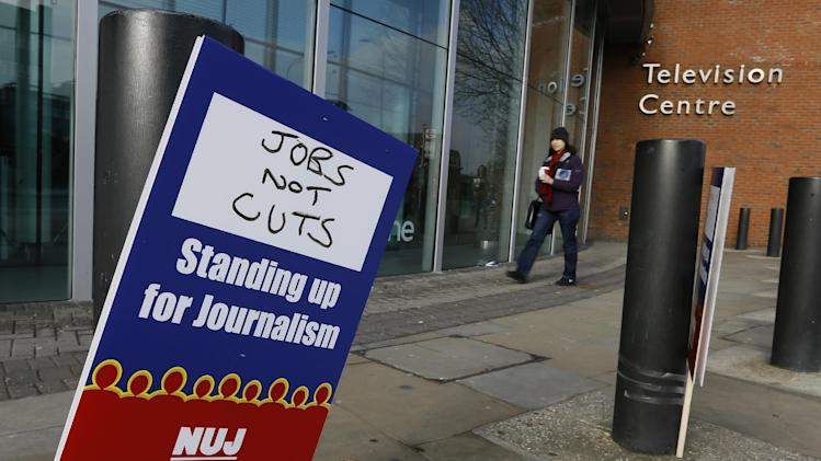 A National Union of Journalists, NUJ, placard taped to a post outside the BBC Television Centre in White City, London,  Monday, Feb. 18, 2013. BBC journalists have gone on strike for 24 hours after the NUJ failed to reach an agreement with management in a disagreement over redundancies. (AP Photo/Kirsty Wigglesworth)