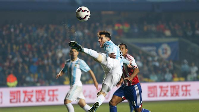 Argentina's Lionel Messi goes for a high ball during a Copa America semifinal soccer match against Paraguay at the Ester Roa Rebolledo Stadium in Concepcion, Chile, Tuesday, June 30, 2015. Argentina beat Paraguay 6-1 in the Copa America semifinals on Tuesday, setting up a final against host Chile.(AP Photo/Andre Penner)
