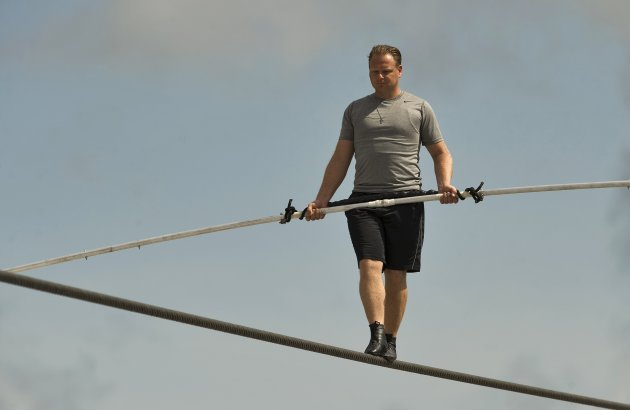 High wire walker Nik Wallenda balances on a 1,200 foot-long cable during practice session in Sarasota, Florida