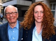 "Rebekah Brooks (R), former chief executive of Rupert Murdoch's News International, has been charged with phone hacking, British prosecutors announced on Tuesday. Brooks said she was ""not guilty of these charges"", calling them ""distressing"""