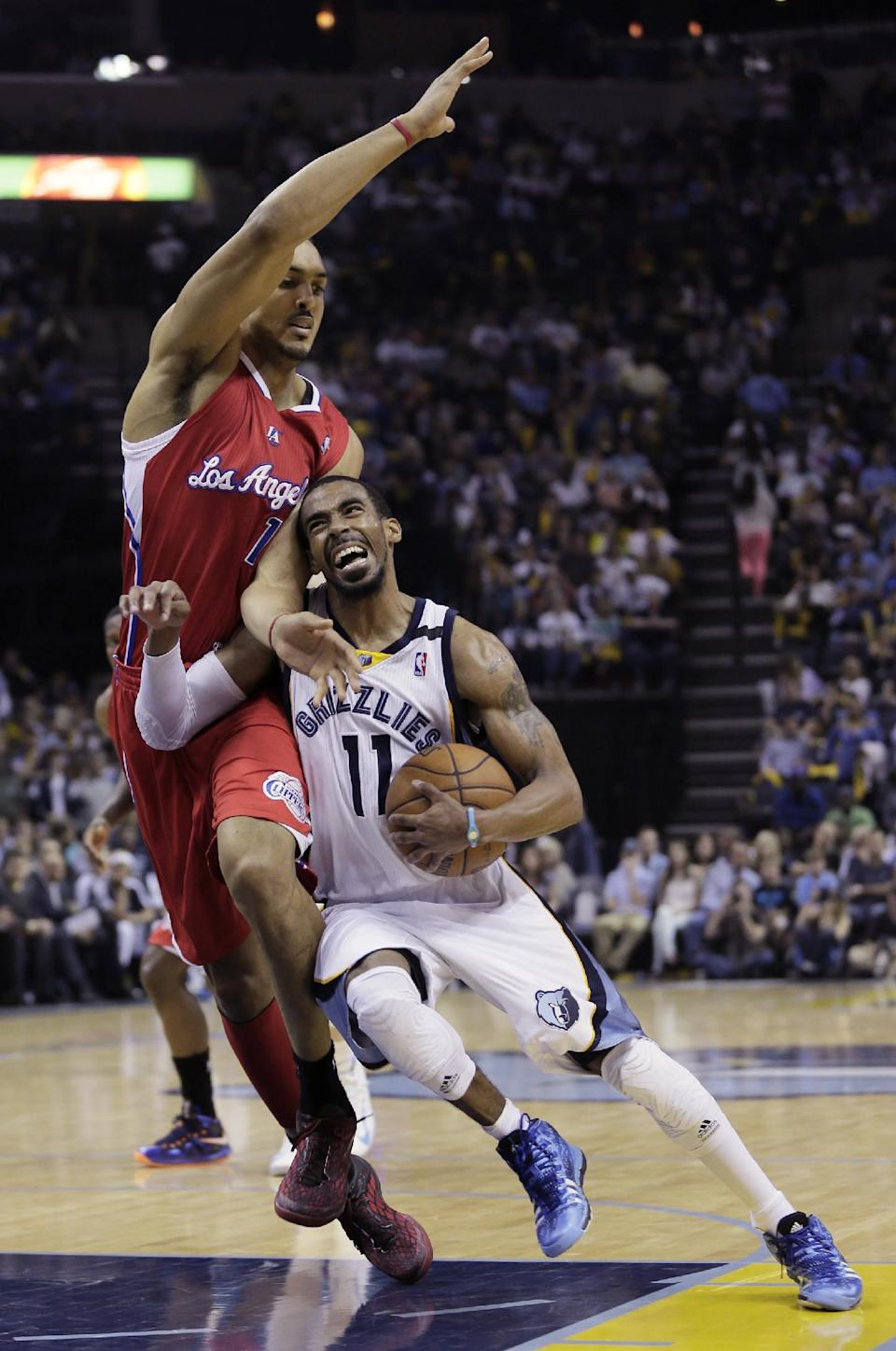 Memphis Grizzlies' Mike Conley (11) is fouled by Los Angeles Clippers' Ryan Hollins during the second half of Game 4 in a first-round NBA basketball playoff series in Memphis, Tenn., Saturday, April 27, 2013. The Grizzlies defeated the Clippers 104-83. (AP Photo/Danny Johnston)