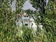 The last hideout of Al-Qaeda leader Osama bin Laden is seen through trees in Abbottabad …