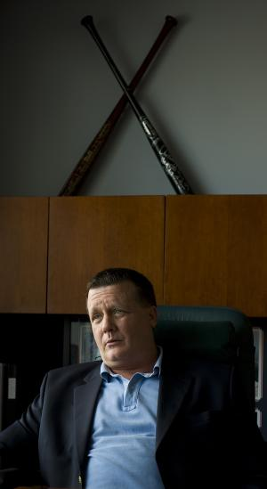 """FILE - In this Jan. 24, 2008, file photo, then-New York Yankees general partner Hank Steinbrenner sits in his office during an interview in Tampa, Fla. Steinbrenner, now co-chairman of the Yankees, thinks his team's celebration of its 2009 World Series championship may have lasted too long. """"I think, maybe, they celebrated too much last year,"""" Steinbrenner said Monday, Feb. 21, 2011. """"Some of the players, too busy building mansions and doing other things and not concentrating on winning. I have no problem saying that."""" (AP Photo/Steve Nesius, File)"""