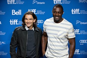 Director Justin Chadwick, left, poses with actor Idris…