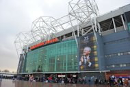 Old Trafford stadium in Manchester, England, in 2011. Britain's fabled Manchester United football club was headed for a listing on the New York Stock Exchange Thursday via an IPO aimed at raising $300 million for the team and its American owners