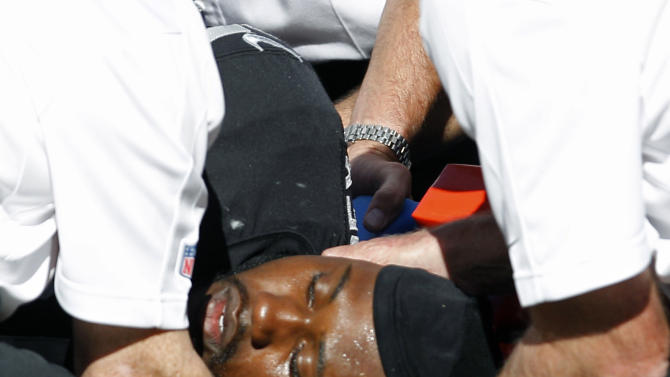 Oakland Raiders wide receiver Darrius Heyward-Bey is tended to by medics after being injured during the fourth quarter of an NFL football game against the Pittsburgh Steelers in Oakland, Calif., Sunday, Sept. 23, 2012. Oakland won 34-31. He was taken to the hospital with a neck injury after a helmet-to-helmet hit from Steelers' Ryan Mundy that was not penalized. (AP Photo/Tony Avelar)