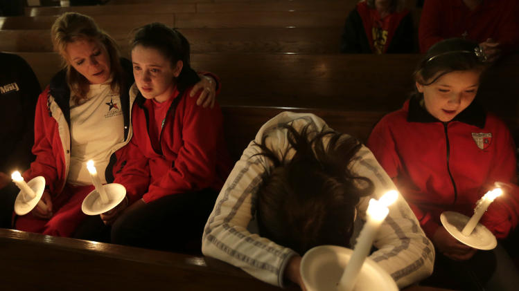 Mourners attend a service at St. Mary's Church of the Assumption Thursday, April 18, 2013, a day after an explosion at a fertilizer plant in West, Texas. The massive explosion at the West Fertilizer Co. Wednesday night killed as many as 15 people and injured more than 160. (AP Photo/Charlie Riedel)