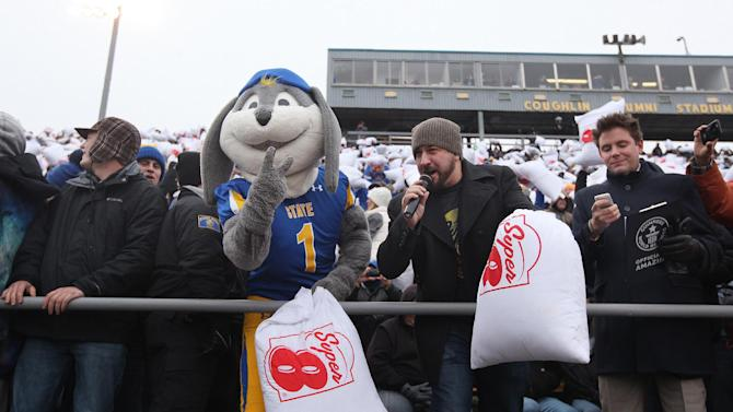 IMAGE DISTRIBUTED FOR SUPER 8 - Joey Fatone, TV host and former member of NSYNC and South Dakota State University's Jack the Jackrabbit, kicked off Super 8's pillow fight in Coughlin Alumni Stadium on Saturday, November 22, 2014 by swinging the inaugural pillow. (Photo by Jay Pickthorn/Invision for Super 8/AP Images)
