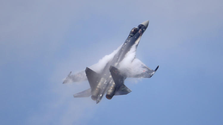A Sukhoi SU-35 jetfigther performs its demonstration flight during the 50th Paris Air Show at Le Bourget airport, north of Paris, Thursday, June 20, 2013. (AP Photo/Francois Mori)
