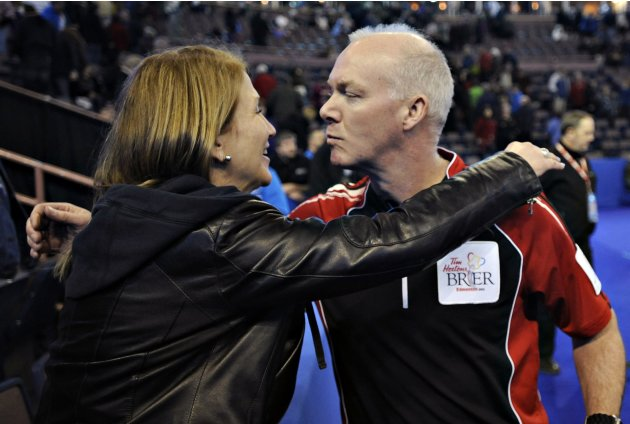 Ontario skip Howard is congratulated by his wife Judy after winning  the bronze medal game at the Canadian Men's Curling Championships in Edmonton