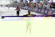 Gold medalist Ethiopia's Tiki Gelana crosses the finish line ahead of silver medallist Priscah Jeptoo of Kenya in the London Olympics women's marathon