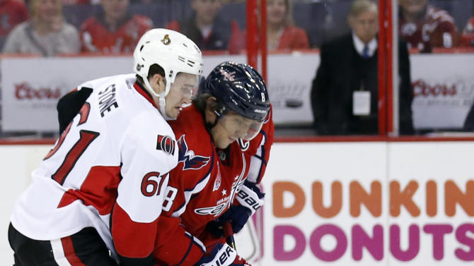 Washington Capitals left wing Alex Ovechkin (8), of Russia, and Ottawa Senators right wing Mark Stone (61) go for the puck in the first period of an NHL hockey game, Monday, Dec. 22, 2014, in Washington. (AP Photo/Alex Brandon)