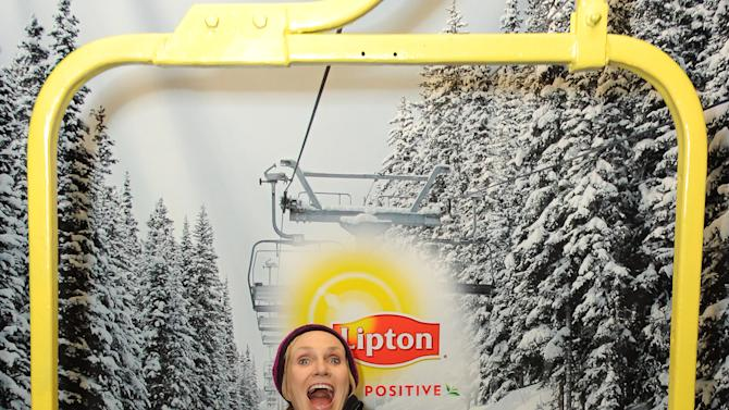 IMAGE DISTRIBUTED FOR LIPTON: Comedian Jane Lynch gleefully sings while riding the ski lift at the Lipton Uplift Lounge during Sundance on Sunday Jan. 20, 2013, in Park City, UT. (Photo by Jordan Strauss/Invision for Lipton/AP Images)