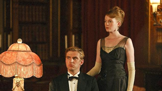 """In this image released by PBS, Dan Stevens as Matthew Crawley, left, and Zoe Boyle as Lavinia Swire are shown in a scene from the second season of """"Downton Abbey."""" The 64th annual Primetime Emmy Awards will be presented Sept. 23 at the Nokia Theatre in Los Angeles, hosted by Jimmy Kimmel and airing live on ABC. (AP Photo/PBS, Carnival Film & Television Limited 2011 for MASTERPIECE, Nick Briggs)"""