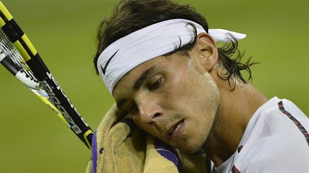 TENNIS Rafael Nadal of Spain wipes his face in his men's singles tennis match against Lukas Rosol of the Czech Republic at the Wimbledon tennis championships in London June 28, 2012