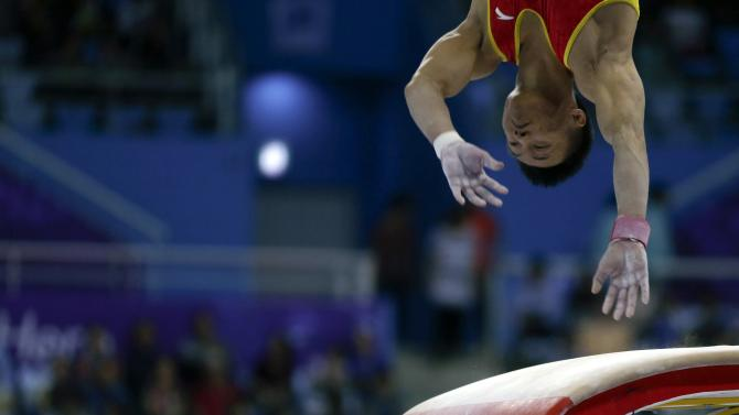 China's Huang Xi competes on the vault in the men's team gymnastics competition at the Namdong Gymnasium Club during the 17th Asian Games in Incheon