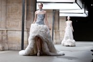 Cast your minds back to March last year when Alexander McQueen's Autumn Winter 2011 show closed during Paris Fashion Week amid a cloud of frothy white dresses