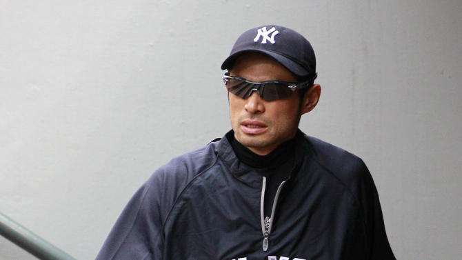 New York Yankees' Ichiro Suzuki walks in the dugout before a game against the Seattle Mariners Monday, July 23, 2012, in Seattle. The Seattle Mariners announced shortly before the news conference that Suzuki, who has played with the Mariners since 2001, was traded to the Yankees. (AP Photo/Elaine Thompson)
