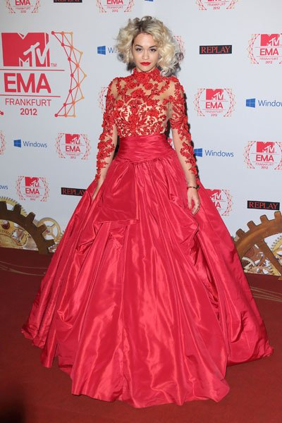 Rita Ora: Somewhere out there, Scarlett O'Hara is missing some curtains. Singer Rita Ora makes sure all eyes are on her in a voluminous fire red lace gown. The detailed lace bits against the sheer fab