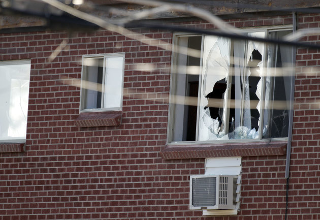 Windows are broken at the apartment of the alleged gunman James Holmes, 24, Friday, July 20, 2012 in Aurora, Colo. Authorities report that 12 died and more than three dozen people were shot during an