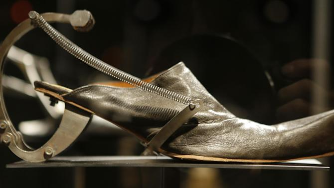 """This Feb. 11, 2013 photo shows Kei Kagami's oxidized metal and leather footwear on display at the """"Shoe Obsession"""" exhibit at The Museum at the Fashion Institute of Technology Museum in New York. The exhibition, showing off 153 specimens, runs through April 13. (AP Photo/Kathy Willens)"""