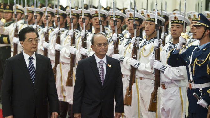 Myanmar's President Thein Sein, right, accompanied by Chinese President Hu Jintao, inspects a guard of honor during a welcome ceremony at the Great Hall of the People in Beijing, China, Friday, May 27, 2011. (AP Photo/Alexander F. Yuan)
