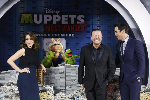 "Cast members Gervais, Fey and Burrell pose with the characters of Constantine, Miss Piggy and Kermit at the premiere of ""Muppets Most Wanted"" at El Capitan theatre in Hollywood"