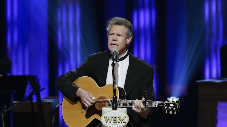 Randy Travis performs during the funeral for country music star George Jones in the Grand Ole Opry House on Thursday, May 2, 2013, in Nashville, Tenn. Jones, one of country music's biggest stars who had No. 1 hits in four separate decades, died April 26.  (AP Photo/Mark Humphrey, Pool)