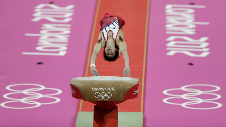 Japanese gymnast Kohei Uchimura performs on the vault during the Artistic Gymnastic men's team final at the 2012 Summer Olympics, Monday, July 30, 2012, in London. (AP Photo/Gregory Bull)