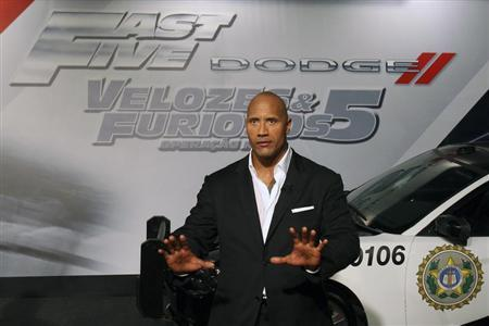 "Actor Dwayne Johnson arrives at the world premiere of ""Fast Five"" at the Cinepolis Lagoon theatre in Rio de Janeiro"