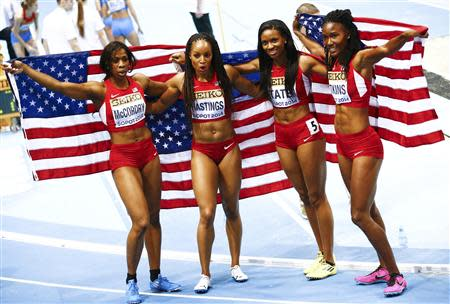 First placed U.S. athletes McCorory, Hastings, Tate and Atkins pose as they celebrate after the women's 4x400 metres relay final at the world indoor athletics championships at the ERGO Arena in Sopot