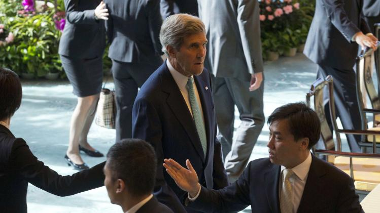 "U.S. Secretary of State Kerry arrives for a ""CEO Roundtable Breakfast"" with Chinese and U.S. business leaders in Beijing"