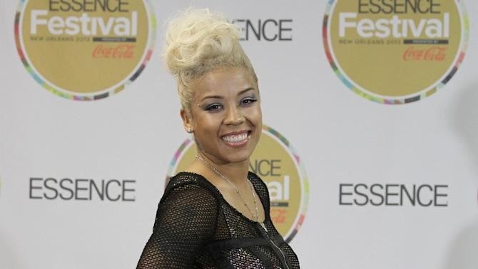 FILE - In this July 6, 2013 file photo, Keyshia Cole visits the pressroom on Day 2 of the 2013 Essence Music Festival at the Mercedes-Benz Superdome, in New Orleans. Los Angeles police say Cole was arrested Friday, Sept. 19, 2014, on suspicion of battery and the Grammy-nominated singer was released from custody hours later. Police did not identify who Cole is accused of attacking around 5 a.m. in west Los Angeles. (Photo by Donald Traill/Invision/AP, file)
