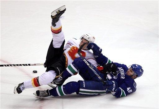 Irving gets 1st NHL win as Flames top Canucks 3-1