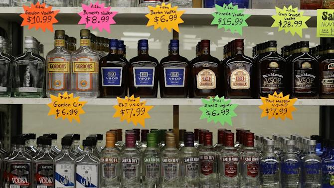 In this April 27, 2013 photo liquor bottles sit on shelves in a market in Baltimore,the government reports on consumer prices for April. The government reports on consumer prices for April on Thursday, May 16, 2013. (AP Photo/Patrick Semansky)