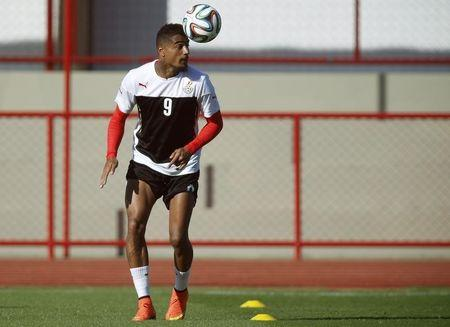 Ghana's Kevin-Prince Boateng heads a ball during a training session in Brasilia