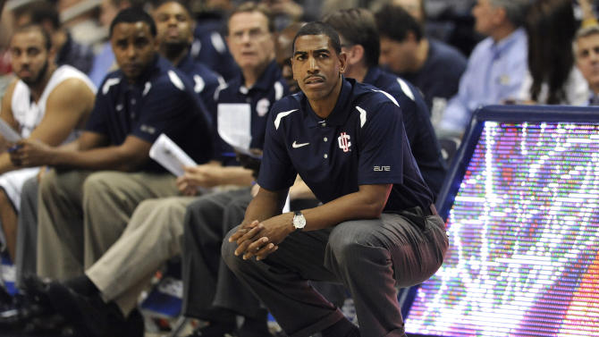 FILE - In this file photo taken Nov. 1, 2012, Connecticut head coach Kevin Ollie, right, watches play during the first half of an NCAA college basketball game in Storrs, Conn. UConn called a news conference for Saturday, Dec. 29, 2012, to announce a new contract for Ollie. A person in the athletic department said the final details were still being worked out and the contract had not been signed. The person spoke on condition of anonymity because he was not authorized to speak before the news conference. (AP Photo/Jessica Hill, file)