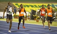 Jamaican sprinters Yohan Blake (R) and Usain Bolt (L) race for the finish during the men&#39;s 200m final of the Jamaican Olympic Athletic Trials at the National Stadium in Kingston, July 01, 2012. Blake stopped the clock at 19.80 sec